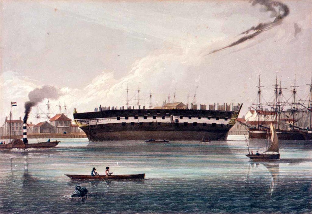 El HMS Téméraire de 98 cañones siendo desmantelado.