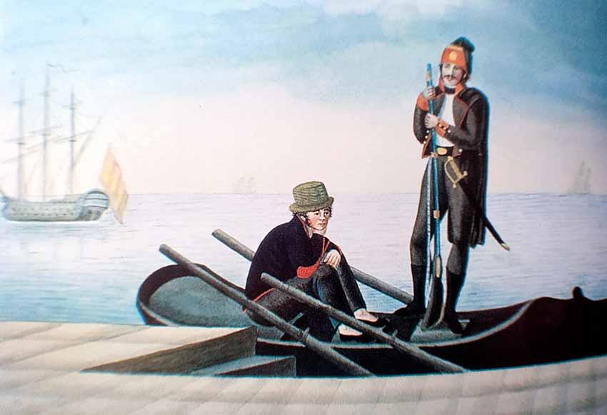 Marinero e infante de marina (con traje de faena) en un bote