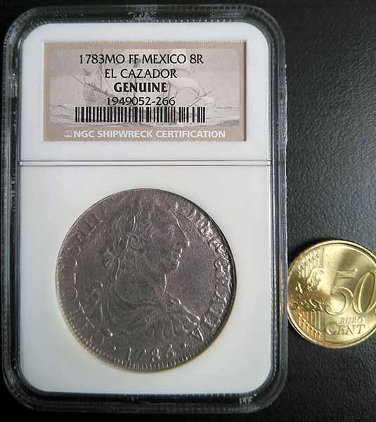 Anverso de una auténtica moneda de El Cazador